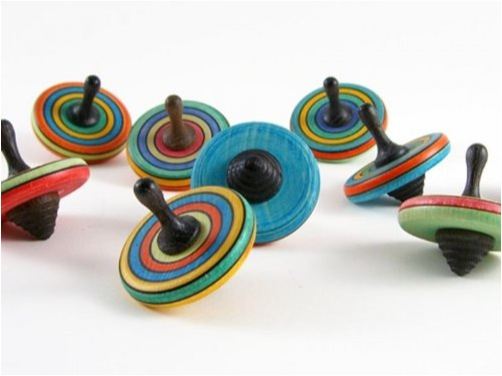 """handmade wooden spinning top"""
